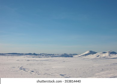 the Arctic landscape. snow plain and the sky.