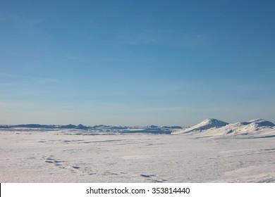 the Arctic landscape. snow plain and the sky.