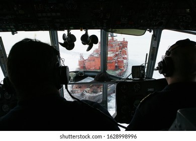 The Arctic Ocean - September 28, 2011: Crew of the Russian Mil Mi-8 helicopter prepare to land on the rear deck of the nuclear-powered icebreaker Rossiya (Russia)