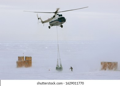 The Arctic Ocean - September 29, 2011: Russian Mil Mi-8 helicopter delivers goods to the new Russian polar station North Pole 39