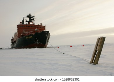 The Arctic Ocean - September 30, 2011: Russian nuclear-powered icebreaker Rossiya (Russia) is moored to a wooden pole stuck to the drift ice in the ocean