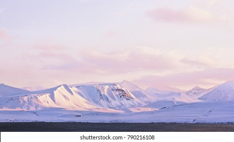 Arctic snow dunes on the coast of Grenfjord, Barentsburg, Svalbard (black and white). Snow ground, arctic snow peaks, silence and calm, background winter landscape.