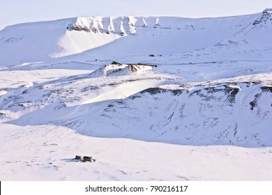 Arctic snow dunes on the coast of Grenfjord, Barentsburg, Svalbard (black and white). Snow ground, arctic snow peaks, silence and calm, background winter landscape