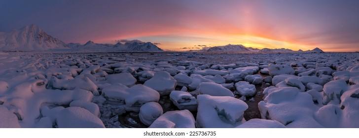 Arctic sunrise panorama - glacier ice and snow