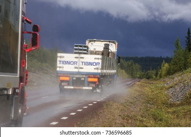 ARCTIC, SWEDEN ON AUGUST 30. View of vehicles on a highway after heavy rain on August 30, 2009 in Arctic, Lapland, Sweden. Forests and rain ahead.