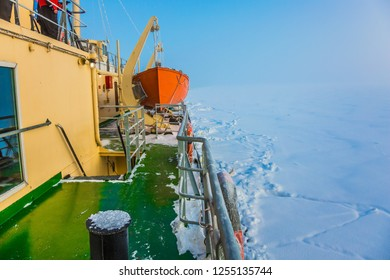 Arctic in winter. Dim northern sun. Excursion to the Arctic sea icebreaker. Unforgettable excursion to the arctic tourist cruise. The concept of active and extreme tourism