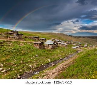 Ardahan Provincial highland houses and rainbow background