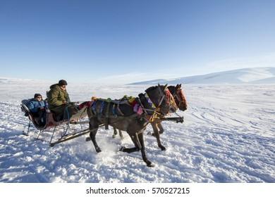 Ardahan, Turkey - January 14, 2017: Sleigh on frozen Cildir lake in Ardahan city of Turkey onJanuary 14, 2017.