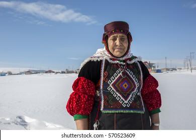 Ardahan, Turkey - January 17, 2017: Fidan Atmaca in traditional dress at Damal town of Ardahan, Turkey on January 17, 2017. Fidan Atmaca is the last master of traditional handmade Damal dolls.