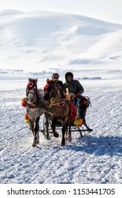 Çıldır, Ardahan / Turkey,02/05/2017: Sleigh trip in frozen Çıldır lake. Çildır lake is the important place of winter tourism in Turkey