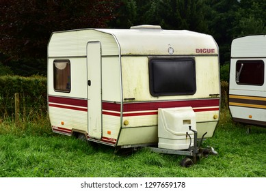 ARDENNES, BELGIUM - AUGUST 17, 2017: Vintage French made towed trailer of the eighties on a camping site in Belgium.