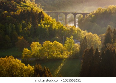 Ardennes, Belgium. Sunrise in countryside and forest near Herbeumont with wonderful viaduc of Hebeumont Viaduc of Conques across Semois river. Luxembourg province, Ardennes region, Wallonia, Belgium.