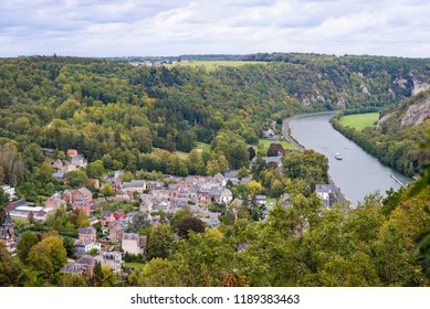 Ardennes. Panorama view on city Waulsort along river Meuse down in valley of Meuse. Rocky cliff and hills in background. Waulsort near Hastiere, Anseremme and Dinant in Wallonia, Ardennes, Belgium.