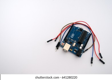 Arduino and around listed wire on a white background