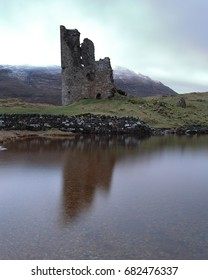 Ardvreck Castle an early morning with the castle reflecting in Loch Assynt
