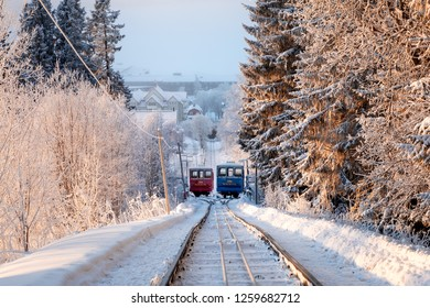 Are, Sweden - Dec 14, 2018: Two trolleys to the mountain railroad in Are, Sweden, opened 1908 as the first permanent connection up to the mountain.