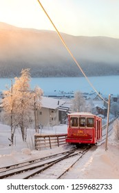 Are, Sweden - Dec 14, 2018: A red trolley at the mountain railroad at the ski resort Are in Sweden, opened 1908 as the first permanent connection up to the mountain.