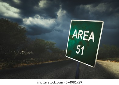 Area 51 sign in the middle of the road with dramatic lighting