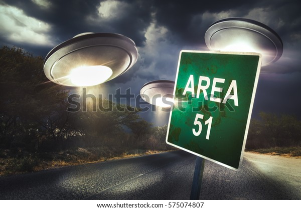 Area 51 sign in the middle of the road with UFOs in the sky and dramatic lighting