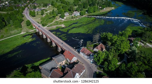 Areal view of The old brick bridge across the Venta river in Kuldiga, Latvia ,the longest bridge of this kind of road bridge in Europe built in 1874 , and Venta rapid in the background