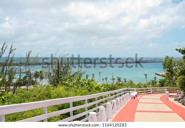 ARECIBO, PUERTO RICO – JULY 30, 2018: Walkway leading to Arecibo Lighthouse overlooking Atlantic Ocean off Puerto Rico's northern coast.