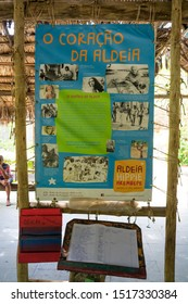 Arembepe, Brazil - Circa September 2019: Information poster showing all the famous people who visited the hippie village, and a guestbook under it
