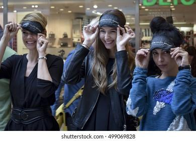 ARENA PLAZA, BUDAPEST, HUNGARY, 14 OCTOBER, 2016: Andrea Osvart, Boglarka Dallos-Nyers and Franciska Farkas at Invisible Exhibition of blind people