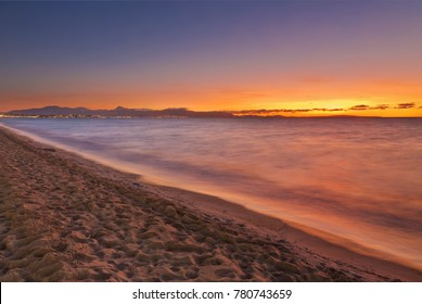 Arenal beach near Palma de Mallorca in sunset time. Mallorca island, Spain Mediterranean Sea, Balearic Islands.