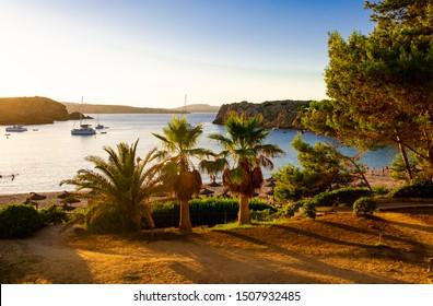 Arenal d'en Castell, Spain 08.09.2019: beach before sunset ...