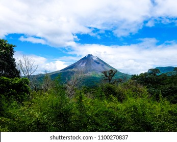 Arenal Volcano with rainforest in the foreground on a cloudy day. Alajuela Province, Costa Rica