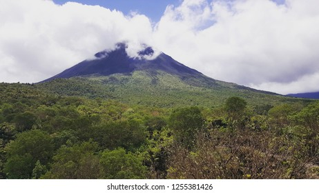The Arenal Vulcano in the rainforest of Costa Rica, Latin America. Clouds hanging above the tops of the mountain.