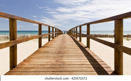 Arenales del Sol, Elche, Spain. May 12, 2016: people walking along the boardwalk to the beach Arenales del Sol