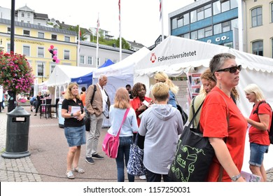 ARENDAL, NORWAY - AUGUST 15, 2018: Many peoples boats and many peoples in the center of city in Arendal, Norway, for Arendal week. All of the political in Norway are in Arendal city this week.