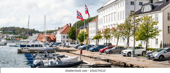 ARENDAL NORWAY - JULY 04, 2019 : Old Building and Tourist boat in the harbour in Arendal, Norway