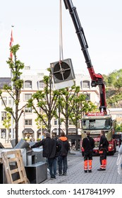 ARENDAL NORWAY - JULY 06, 2019 : Peoples working with moving thing with the crain in the Arendal City, Norway. 2019.