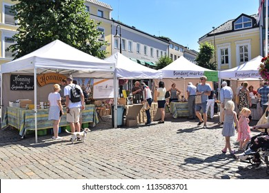 Arendal, Norway. July 2018. A small town and administrative centre of Arendal municipality in Aust-Agder the southern, people enjoying in the city in the farming market day. Norway.