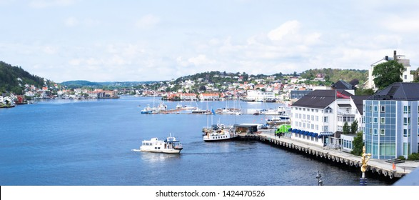 ARENDAL NORWAY - JUNE 14, 2019 : Transport boat in the harbour of Arendal City, Norway.