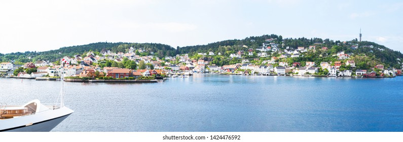 ARENDAL NORWAY - JUNE 14, 2019 : City view and boat in the harbour of Arendal City, Norway.