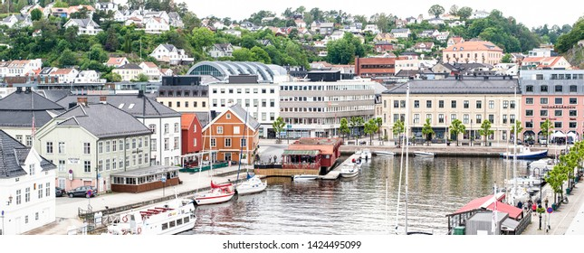ARENDAL NORWAY - JUNE 14, 2019 : City view and boat in Pollen harbour of Arendal City, Norway.