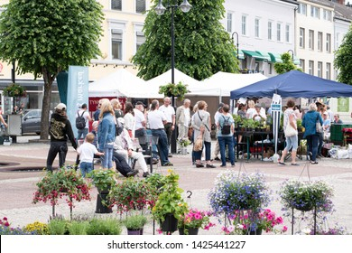 ARENDAL, NORWAY - JUNE, 15,2019: Peoples enjoying the weekend market in the Arendal city. Norway.