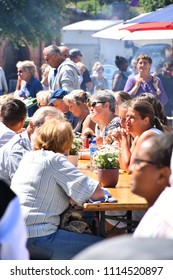 ARENDAL, NORWAY - JUNE 16, 2018: International market, Arendal City. Norway. Many peoples enjoy eating, talking and enjoy the festival at the center of city in Arendal, Norway.