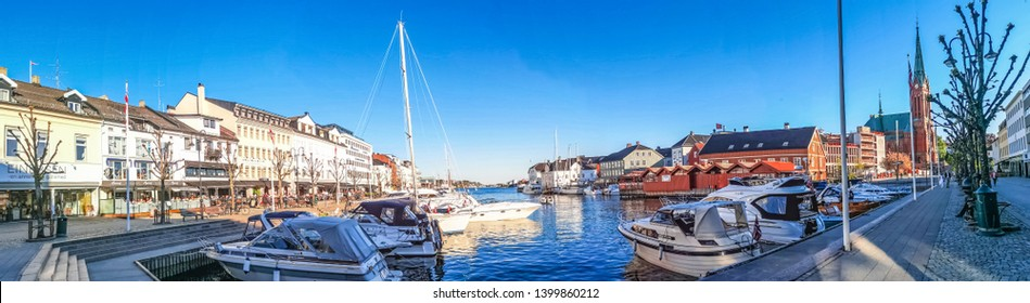 ARENDAL NORWAY - MAY 16, 2019 : Tourist boat in Pollen harbour in Arendal, Norway.