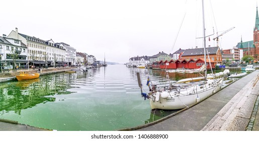 ARENDAL NORWAY - MAY 22, 2019 : Tourist boat in Pollen harbour in Arendal, Norway.
