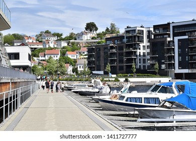 ARENDAL NORWAY - MAY 25, 2019 : Boats in the harbour at Barbu park in Arendal city, Norway.