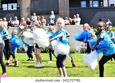 ARENDAL NORWAY - MAY 25, 2019: Group of five years old girls and boy dancing outdoor in the Arendal City, Norway.