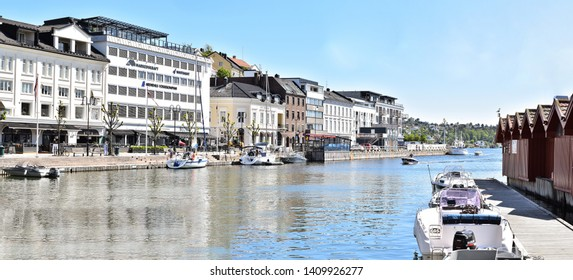 ARENDAL NORWAY - MAY 28, 2019 : Tourist boat in Pollen harbour in Arendal, Norway
