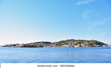 Arendal Sea scape. The beautiful city in the spring time. Nice blue sky.