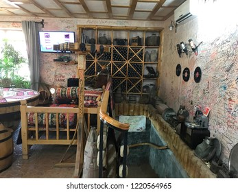 Areni village, Armenia - july 2018: Retro styled winery with lot of vintage objects like vynil discs, magneto phone, printing machine and with a good stock of old armenian wine Areni.
