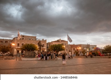 AREOPOLI GREECE, JULY 2019: Scenic view with tourists and visitors in the traditional village of Areopoli, Mani region with the picturesque alleys and the stone built tower houses, Peloponnese, Greece