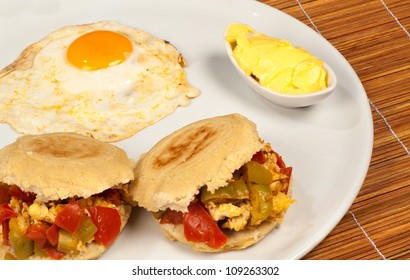 Arepa stuffed with vegetables and scramblesd egg